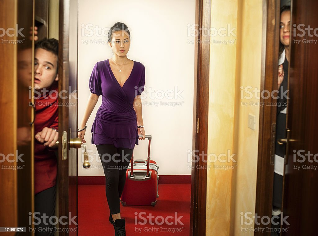 Porter and maid hiding in a hotel room stock photo