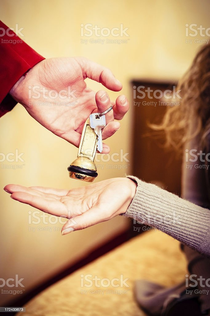 Porter Gives Key Room to Hotel Guest royalty-free stock photo