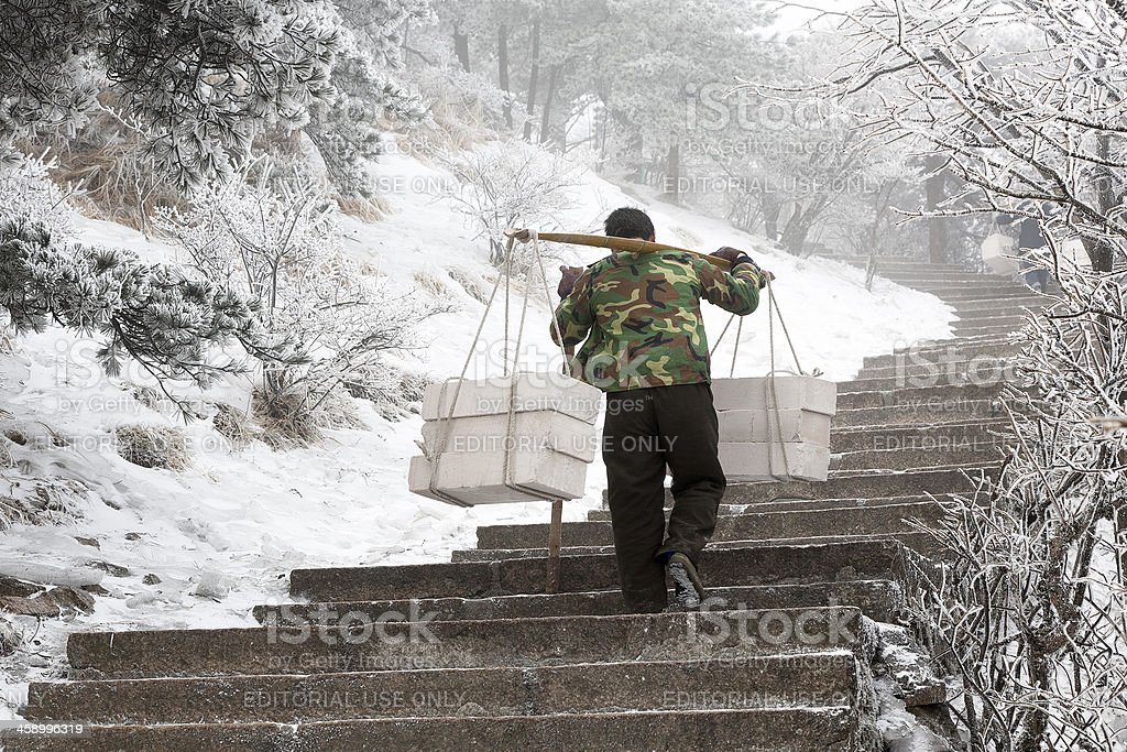 Porter in Huangshan National Park royalty-free stock photo