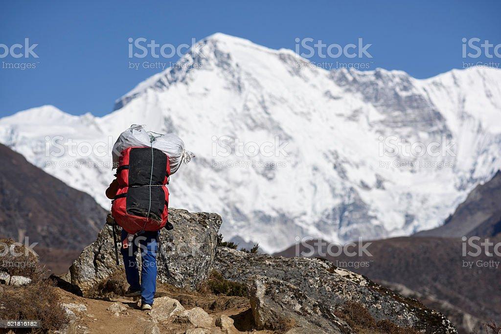 Porter in the Himalaya, Nepal stock photo