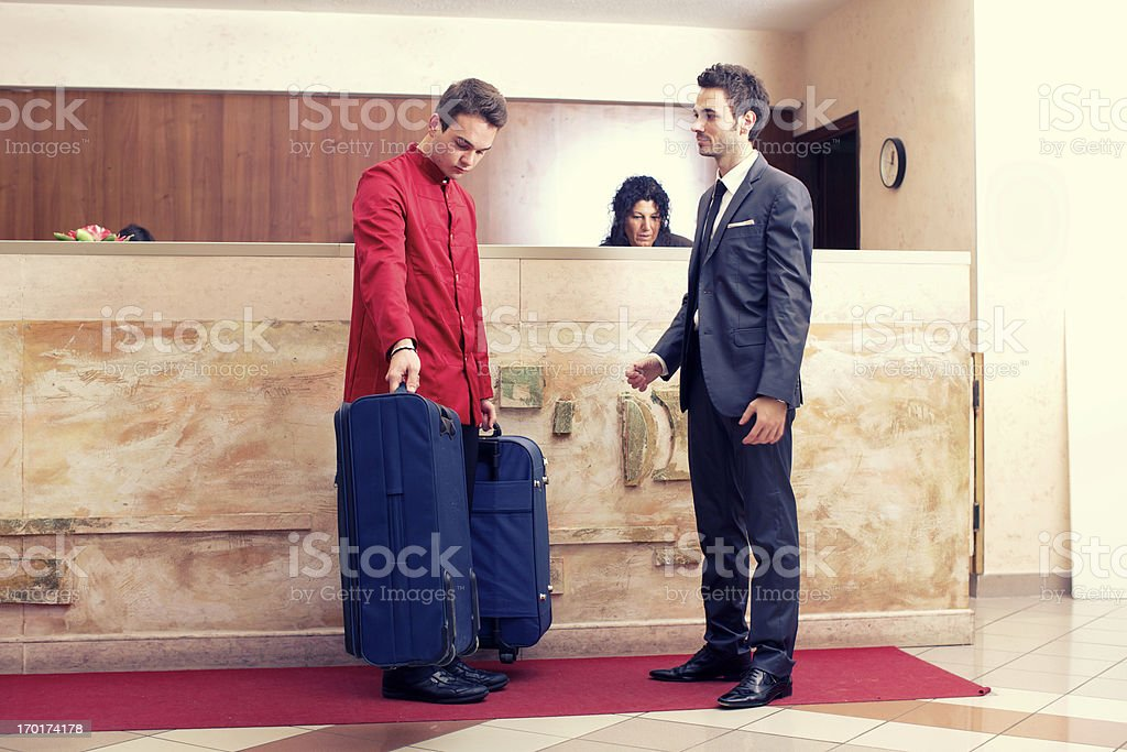Porter invite businessman to follow at the  room, stock photo