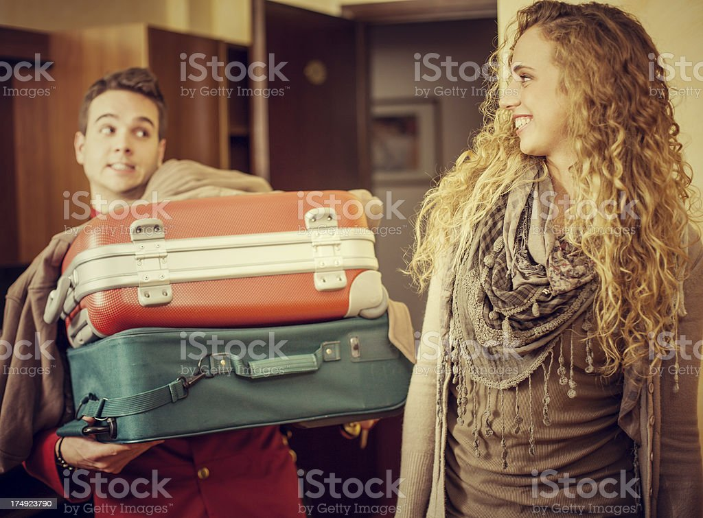 Porter loaded with luggages royalty-free stock photo