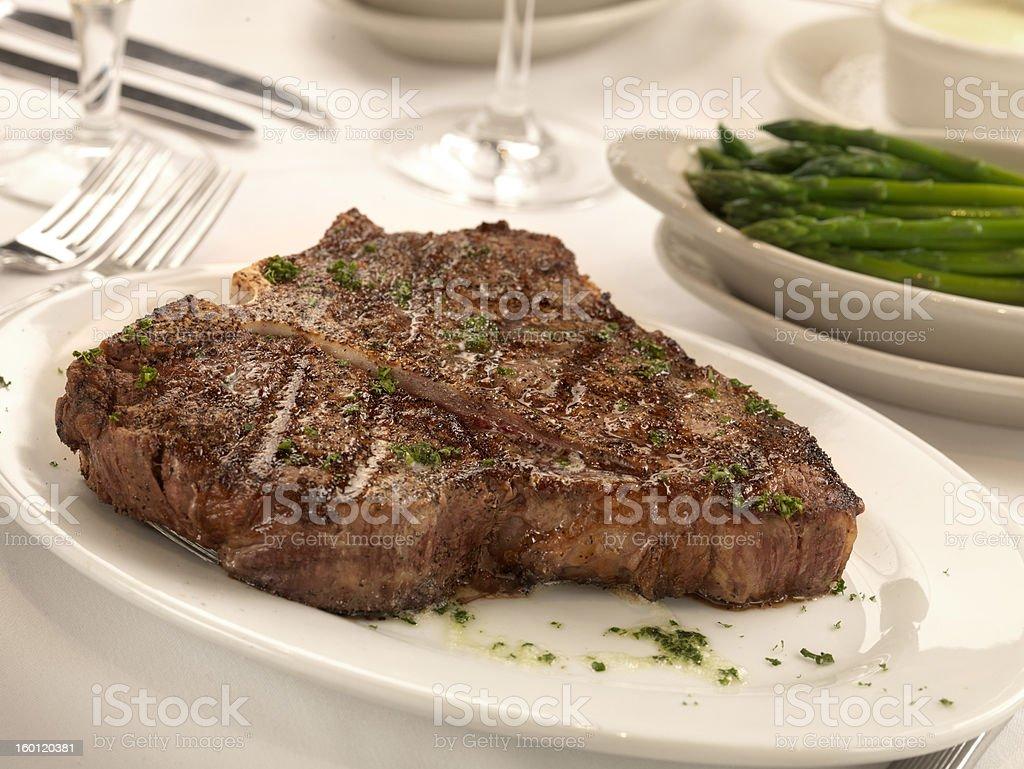 Porterhouse steak and asparagus. stock photo
