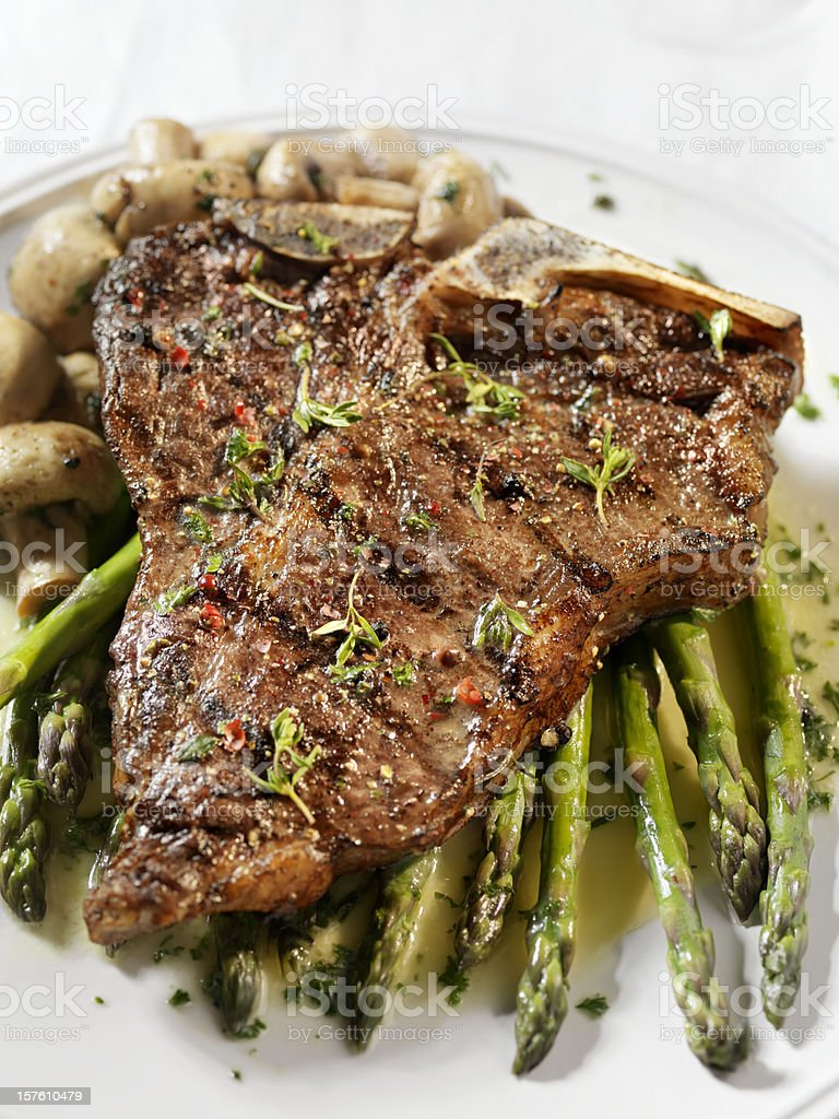 Porterhouse Steak with Asparagus royalty-free stock photo