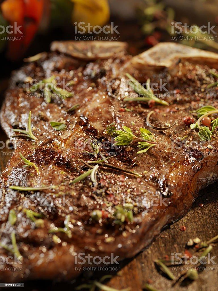 Porterhouse Steak with Fresh Herbs royalty-free stock photo