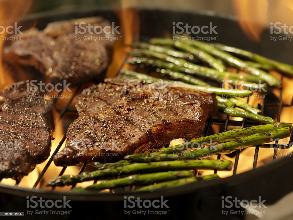 Porterhouse Steaks with Grilled Asparagus royalty-free stock photo