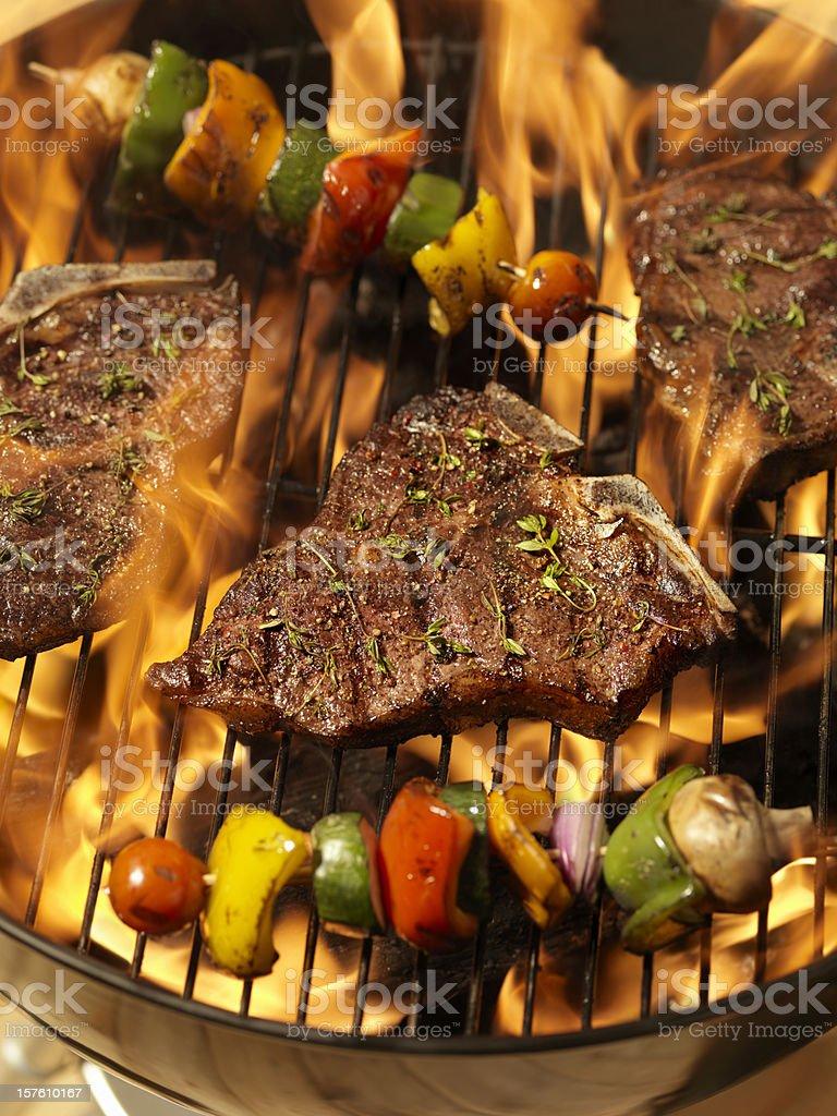 Porterhouse Steaks with Vegetable Skewers royalty-free stock photo