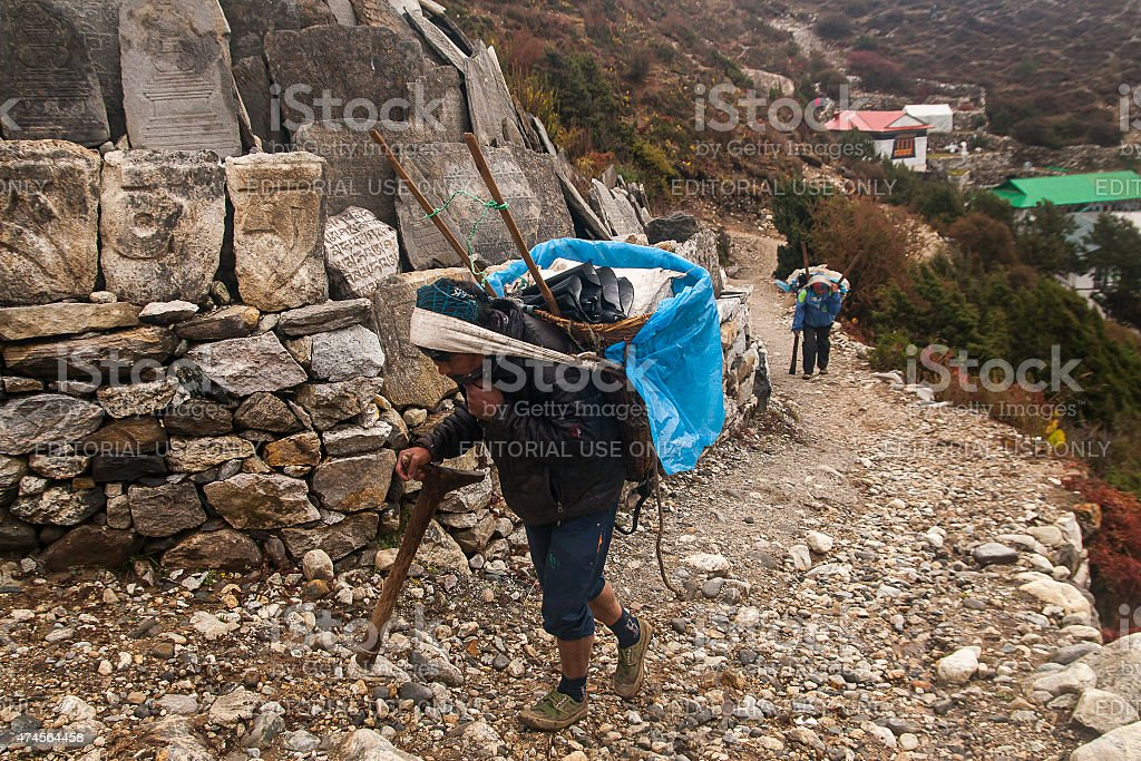 porters in the village of Pangboche stock photo