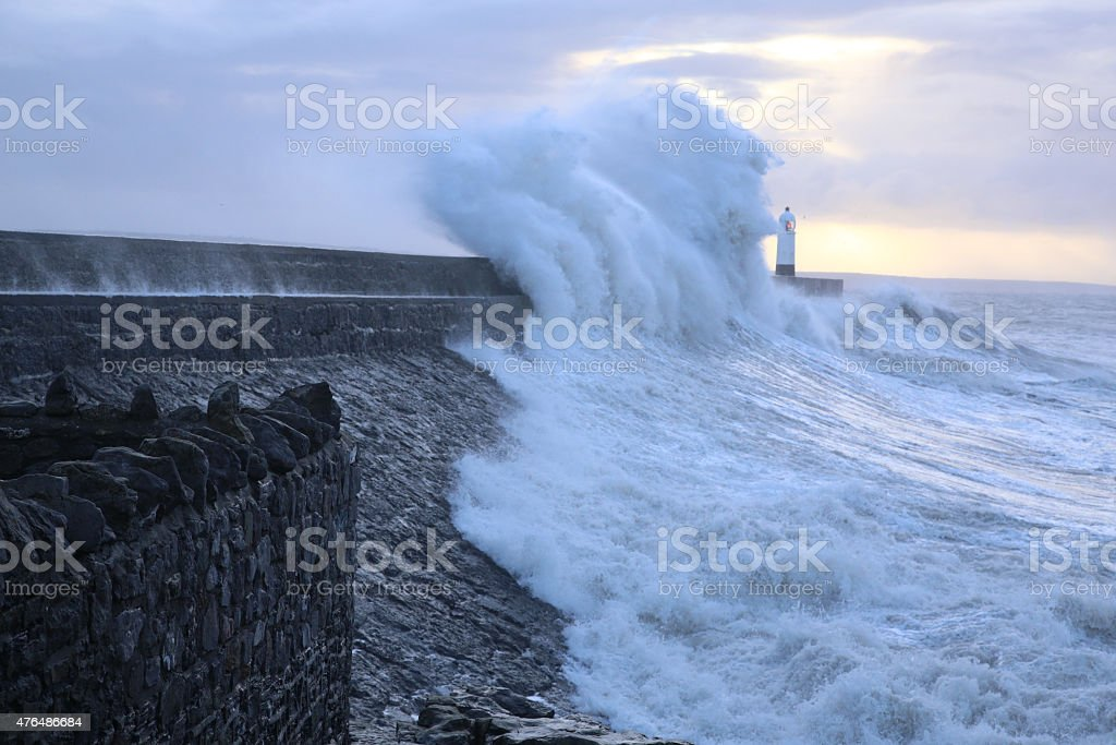 Porthcawl lighthouse, South Wales, UK, in rough seas. stock photo