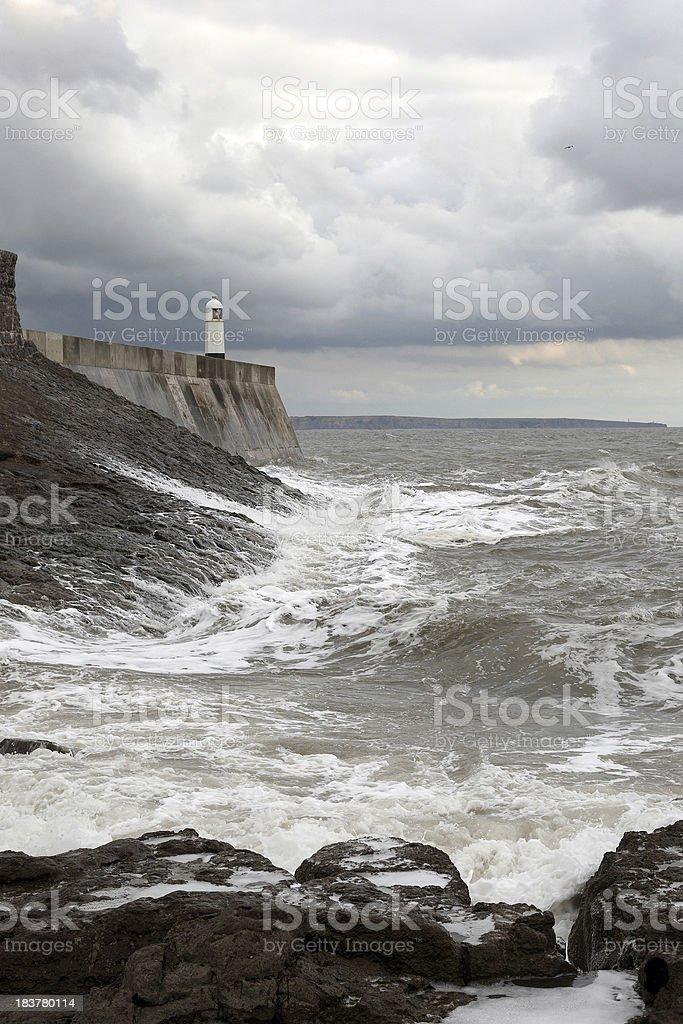 Porthcawl lighthouse waves crashing near sunset royalty-free stock photo