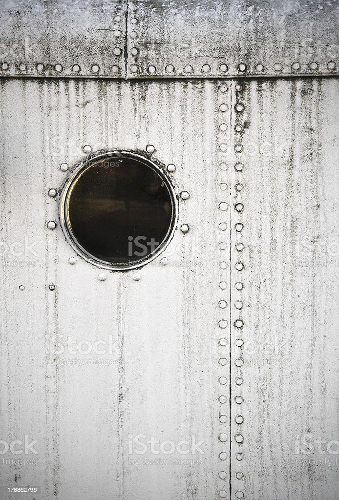Porthole on the white metal naval wall royalty-free stock photo