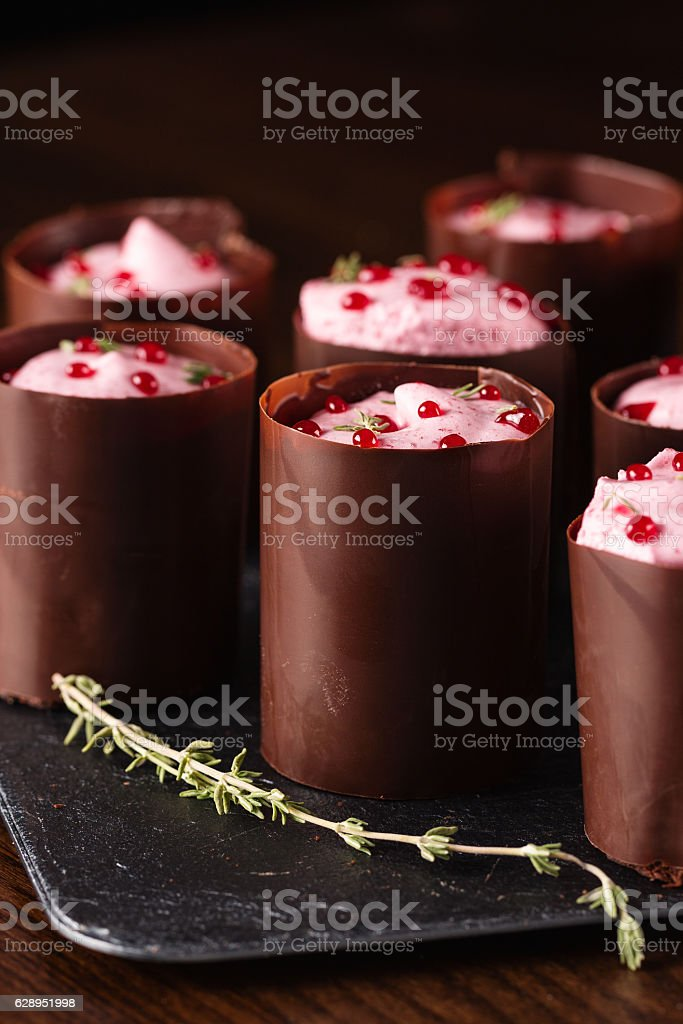 Portion chocolate desserts with berry mousse stock photo