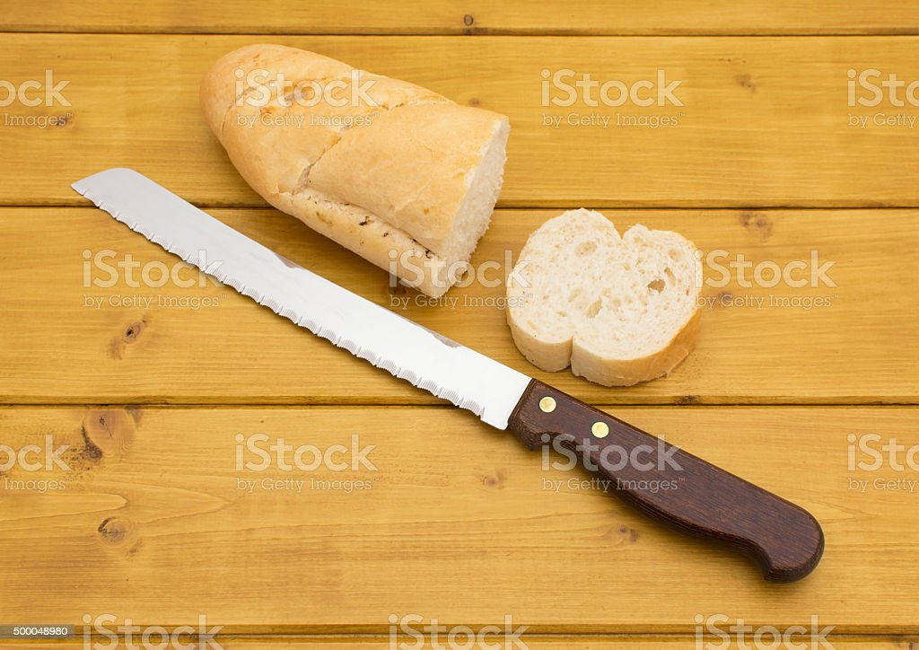 Portion of baguette with a slice cut off stock photo