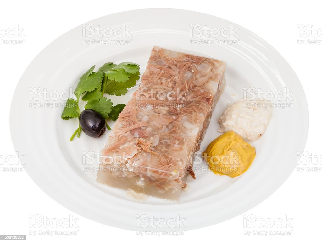 portion of beef aspic with seasonings on plate stock photo