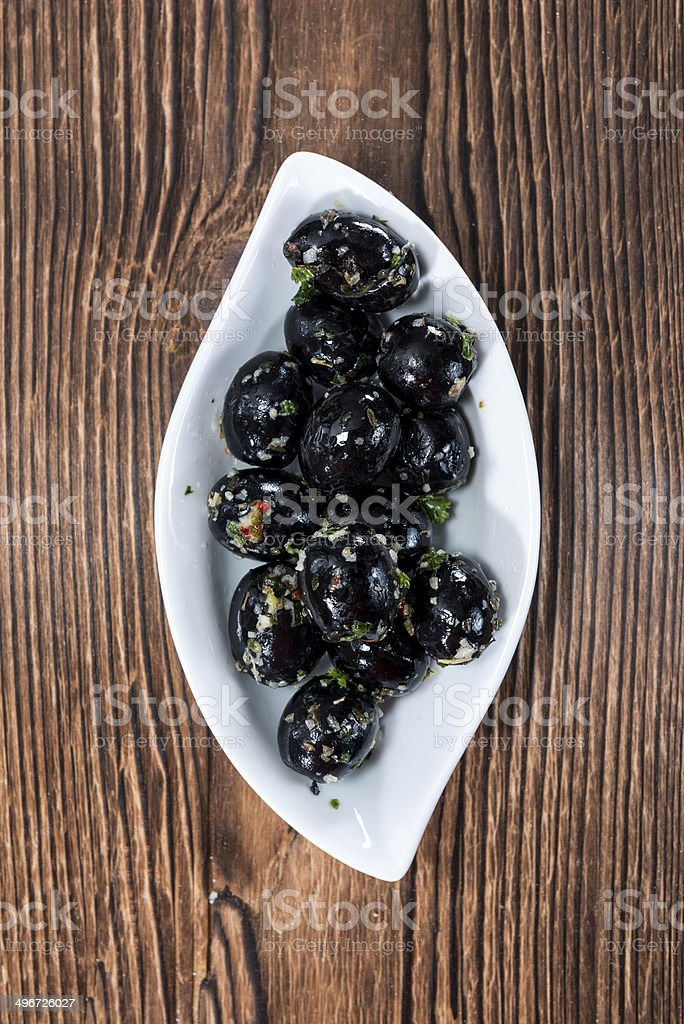 Portion of black Olives stock photo