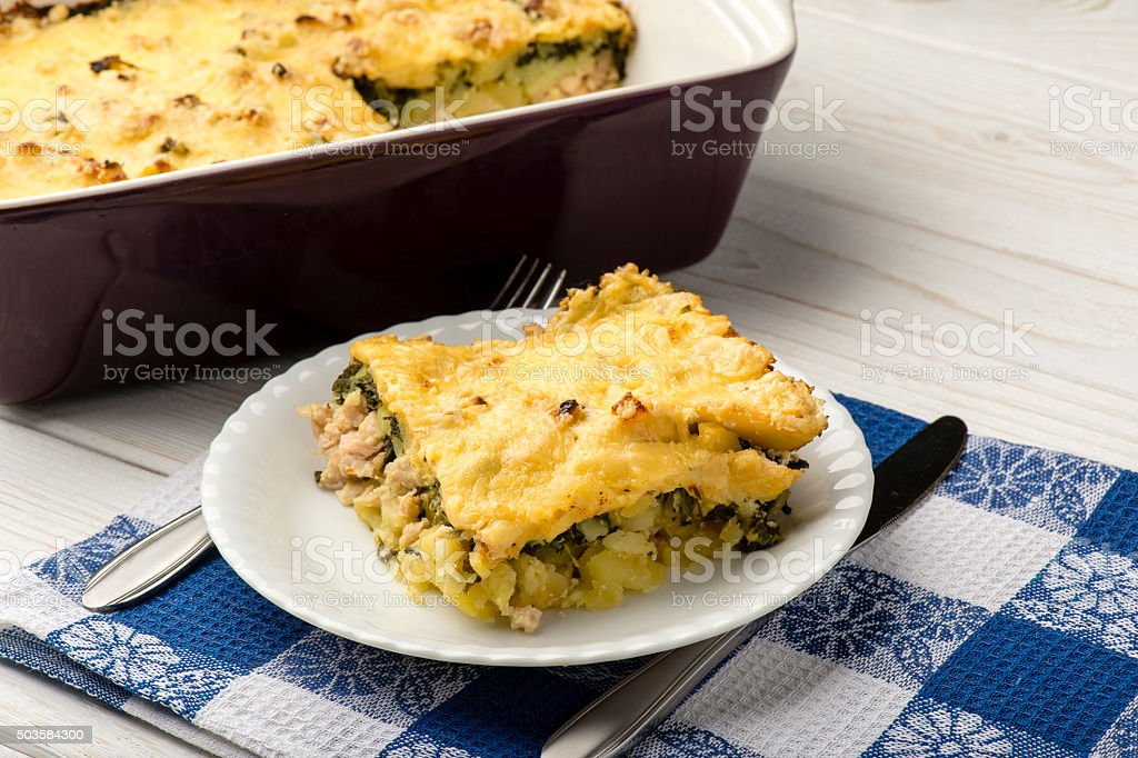 Portion of casserole with spinach, chicken and potatoes. stock photo