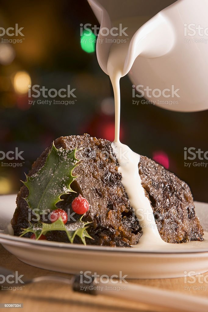 Portion of Christmas Pudding with Cream stock photo