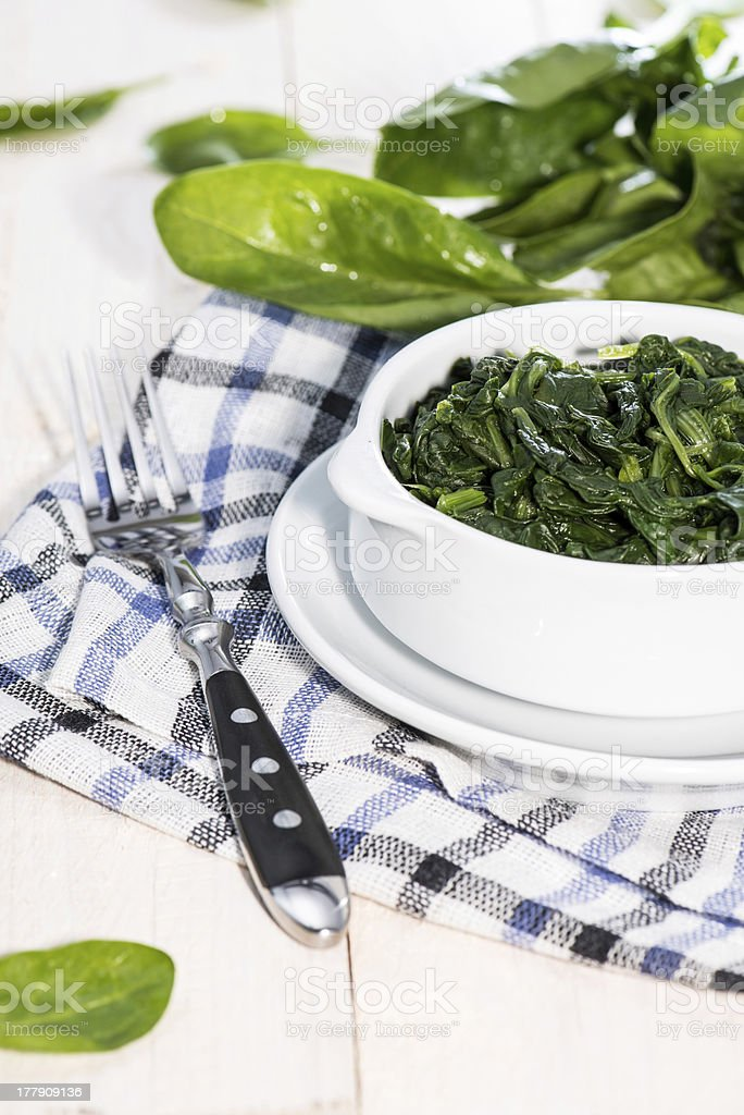 Portion of cooked Spinach stock photo