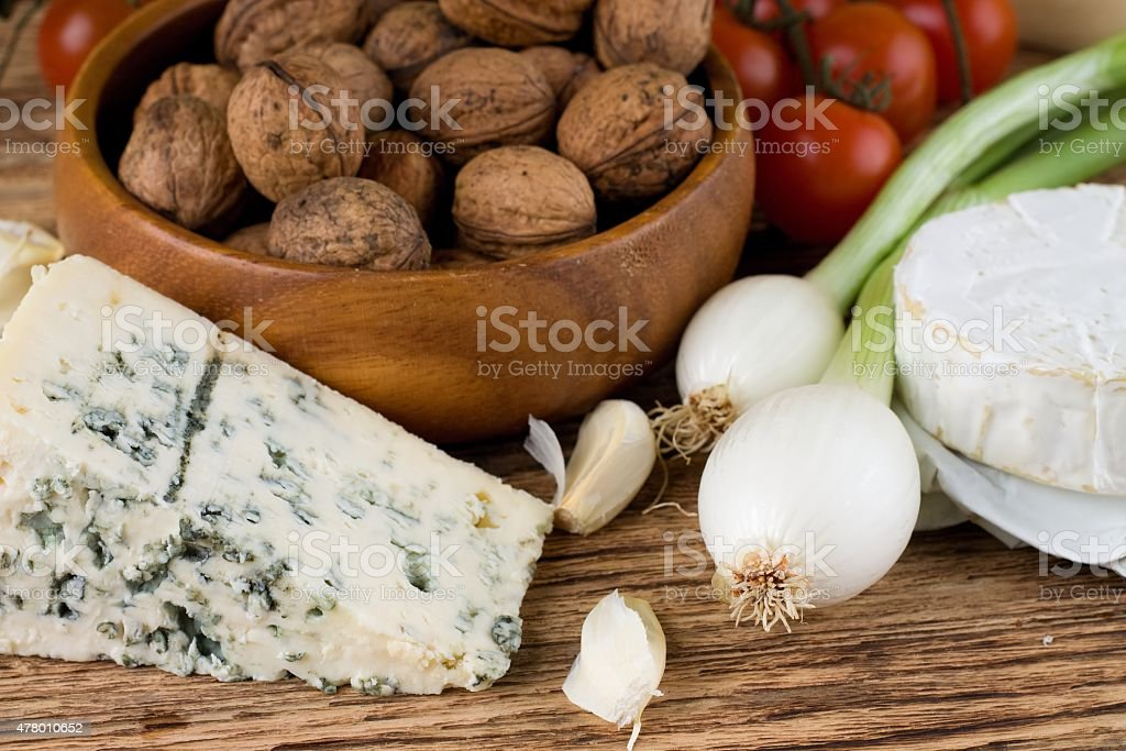 Portion of danish blue cheese and vegetable stock photo