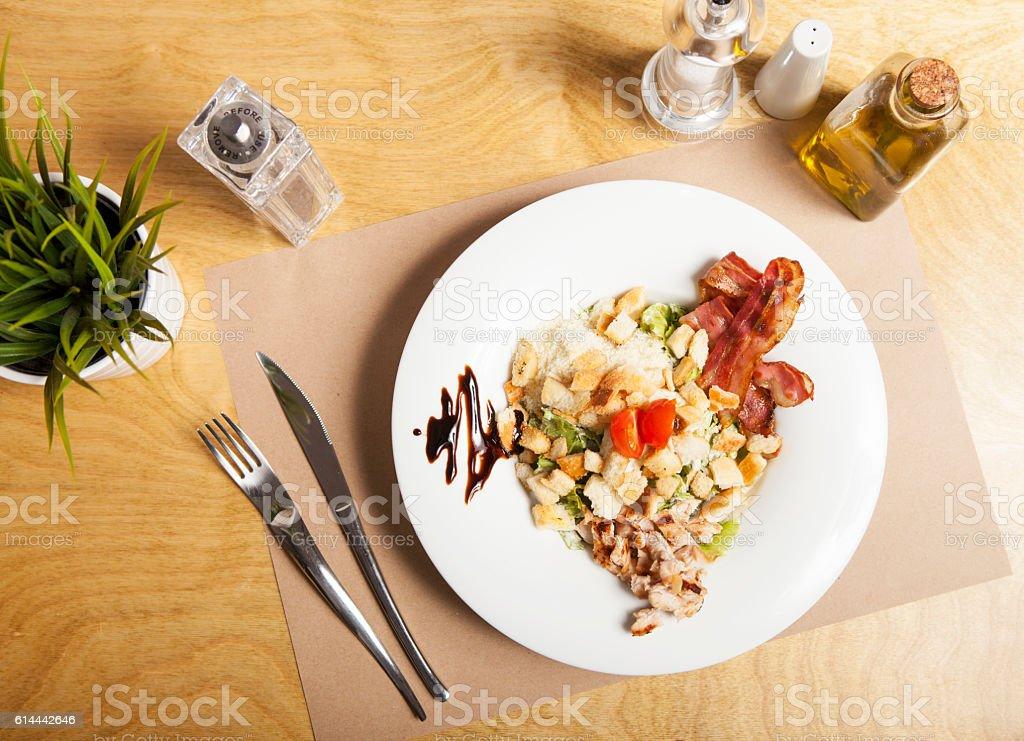 Portion of fresh cesar salad stock photo