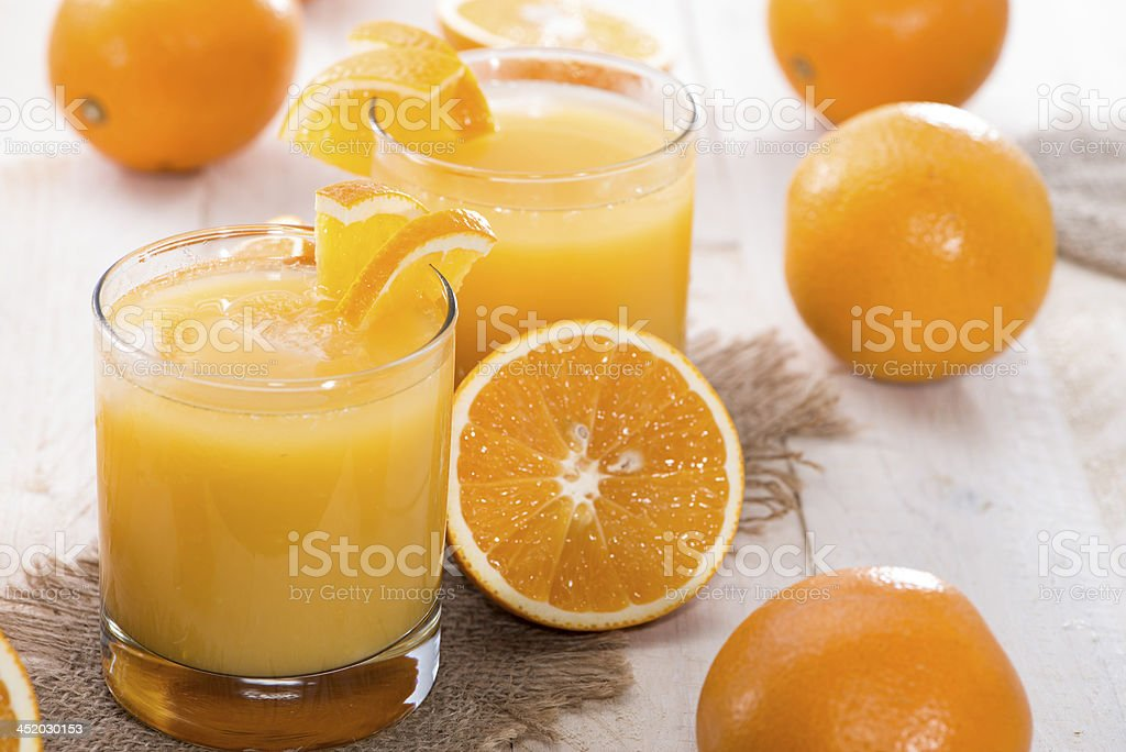 Portion of fresh made Orange Juice stock photo