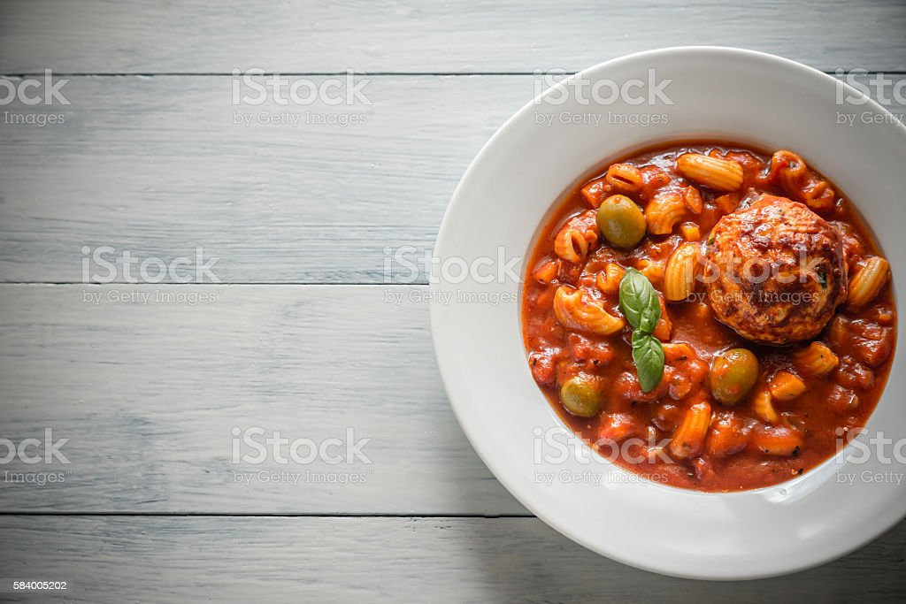 Portion of minestrone soup with meatball stock photo