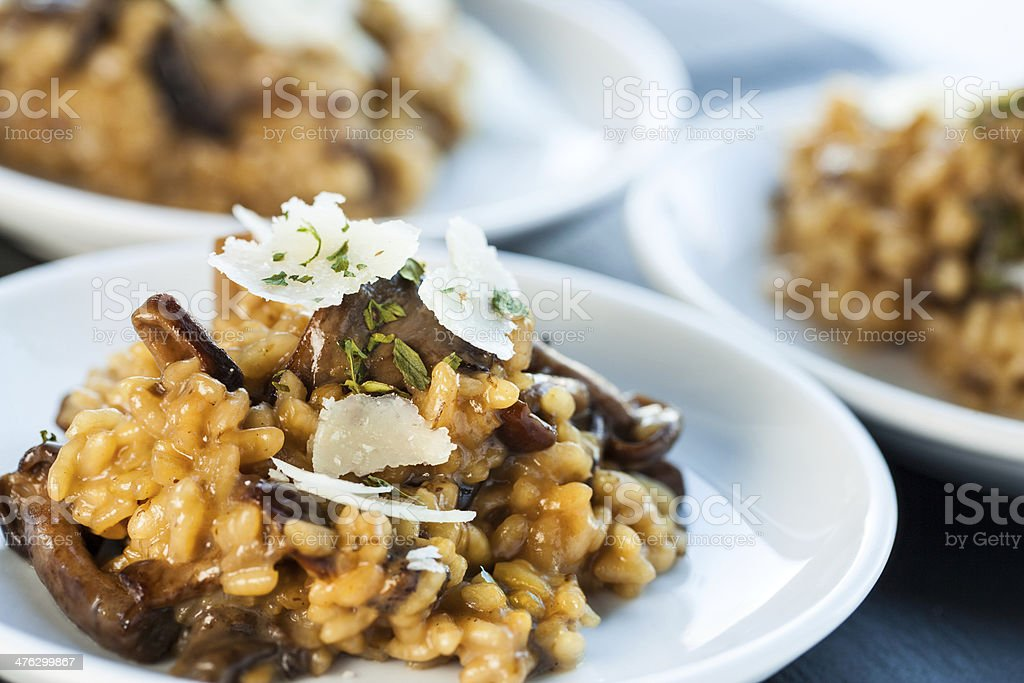 Portion of risotto rice with fungi. stock photo