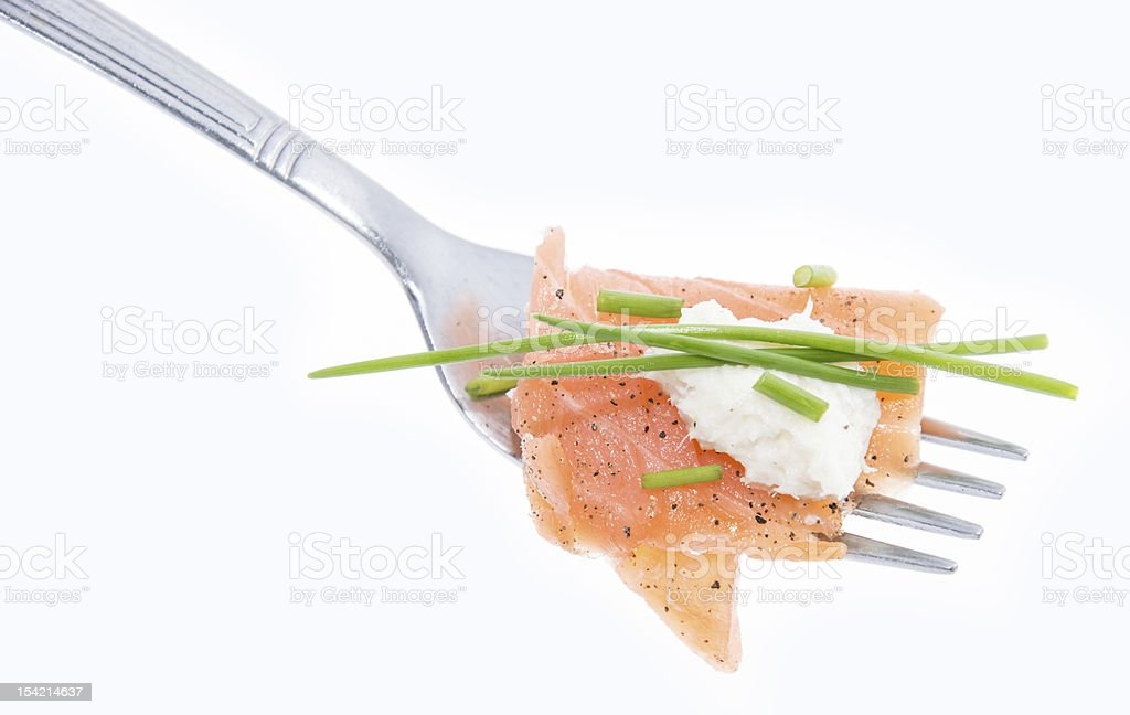 Portion of Salmon on a fork (white) stock photo