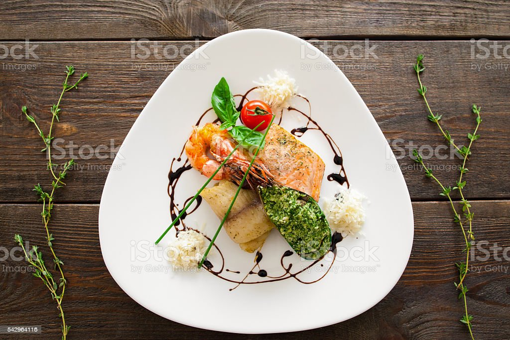 Portion of seafood mix meal on wooden background stock photo