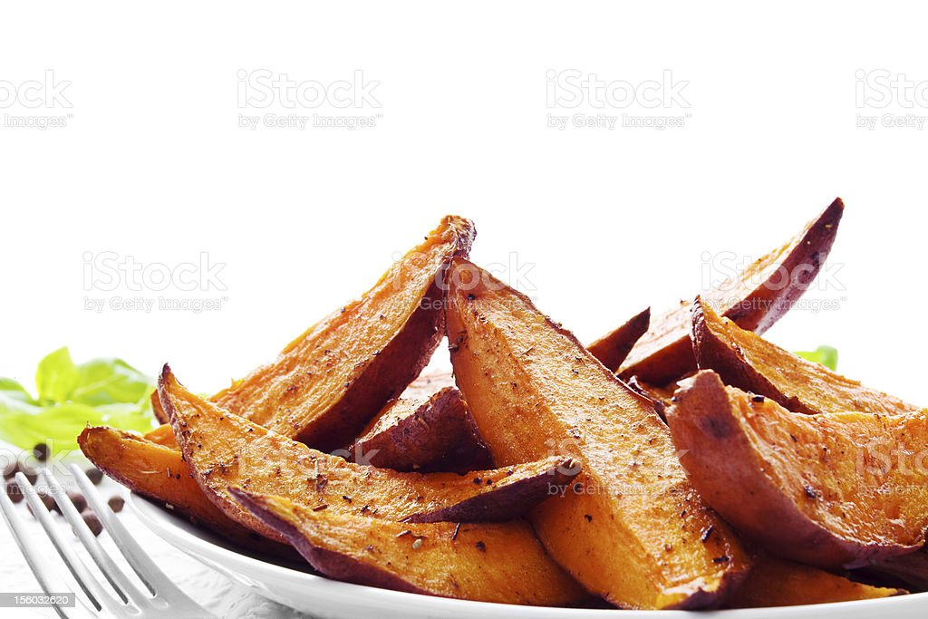 Portion of sweet potato wedges stock photo