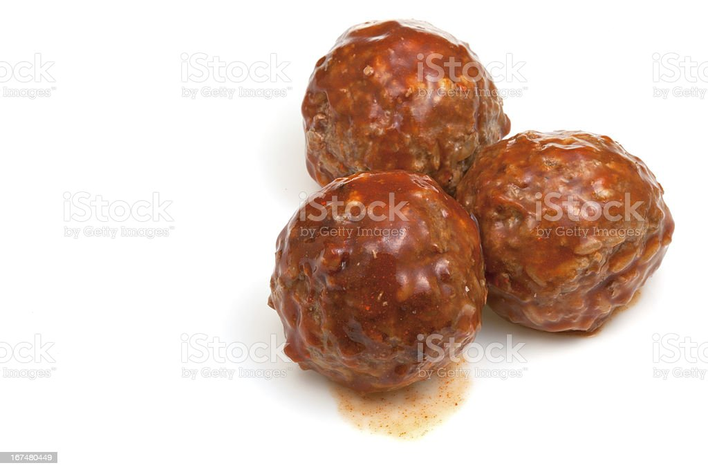 portion roasted meatballs under meat sauce stock photo