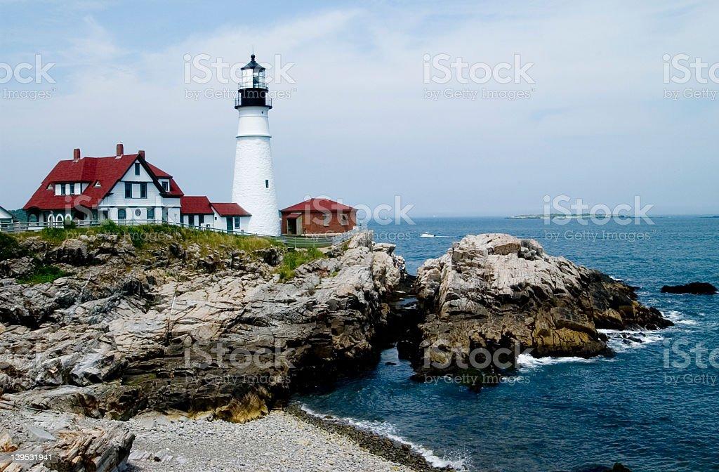 Portland Head Light lighthouse on cliffs in Maine stock photo