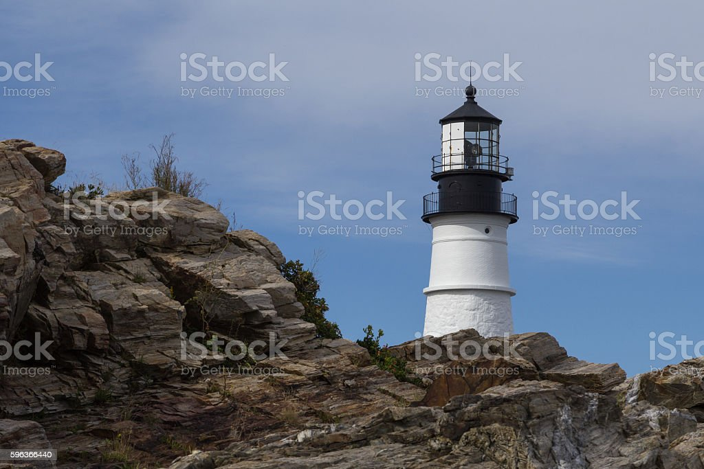Portland Head Light Peaking Out From Behind Some Rocks stock photo