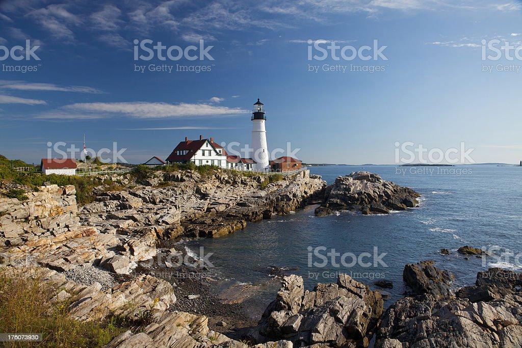 Portland Head Lighthouse and Rocky Shoreline stock photo