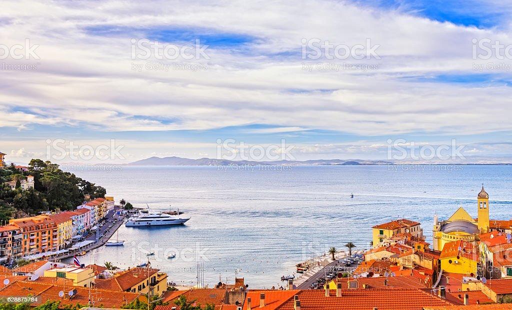 Porto Santo Stefano village, church and seafront panorama. Argen stock photo