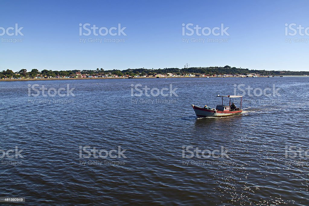 Porto Seguro coast and boat navigating stock photo