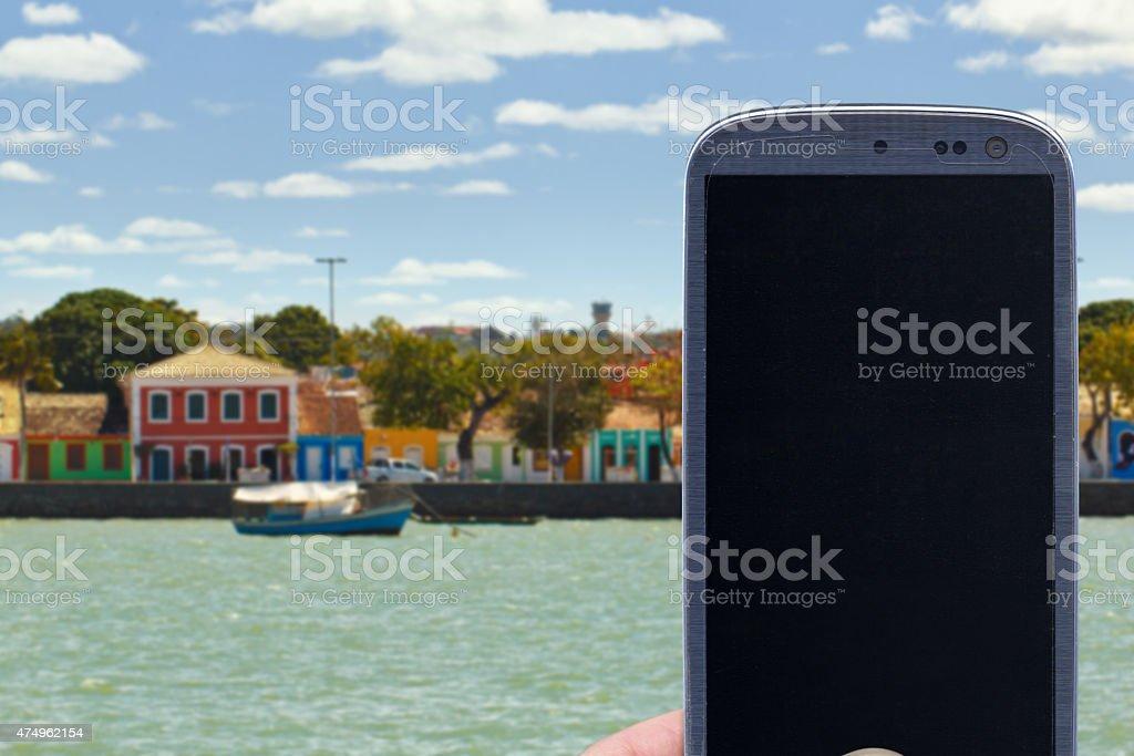 Porto Seguro coast and smartphone stock photo