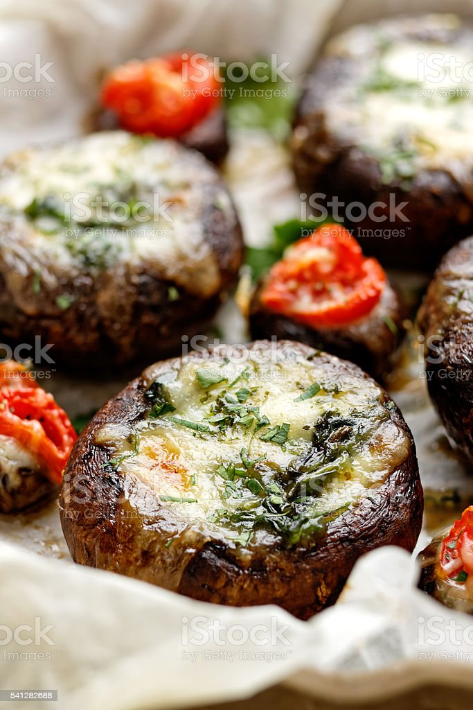Portobello mushrooms stuffed with spinach and cheese stock photo