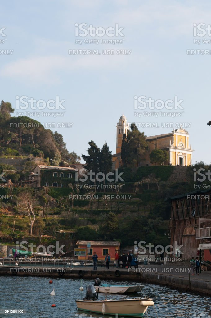 Portofino: boats in the port of Portofino with view of the Castle Brown, formerly known as St. George's Castle, a defensive and noble residence building located on a hill overlooking the bay stock photo