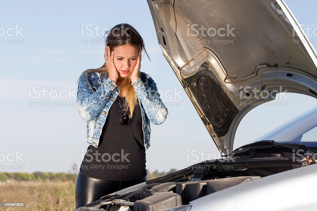 portrait abaout a beautiful woman, car defect stock photo