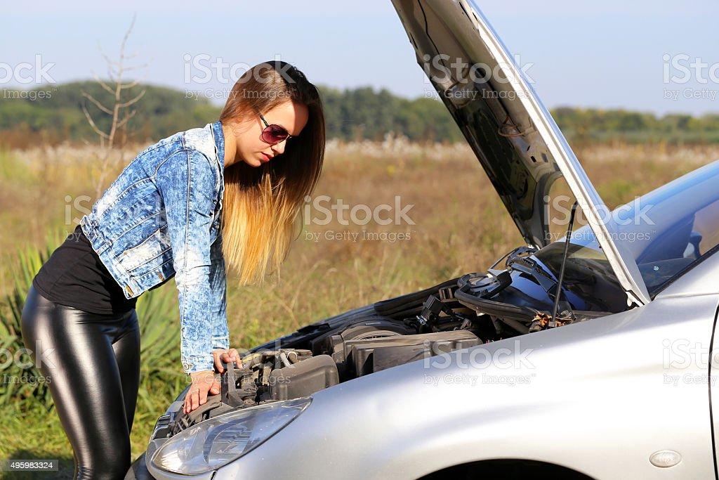 portrait abaout a beautiful woman, car defect stock photo