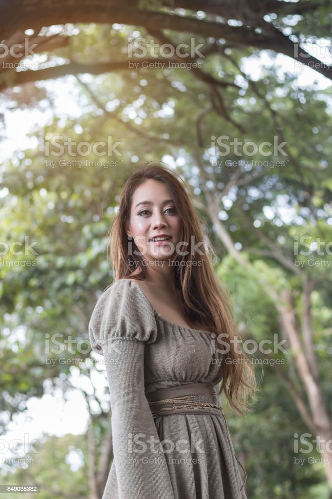 Portrait art of beautiful women in nature park background stock photo