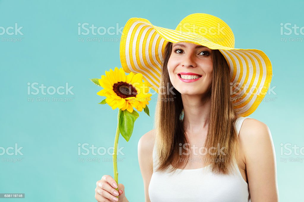 portrait attractive woman with sunflower stock photo