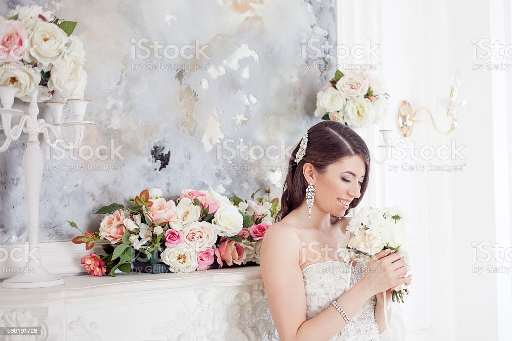 Portrait beautiful bride with a bouquet of flowers. Wedding decoration stock photo