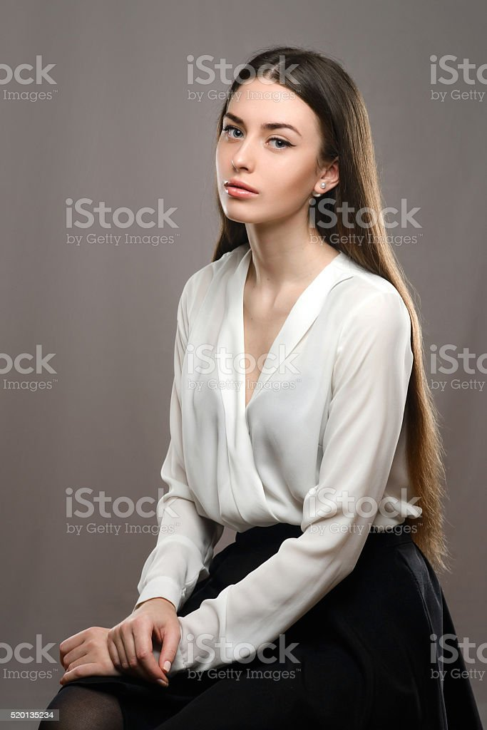Portrait beautiful girl in white blouse and black skirt stock photo