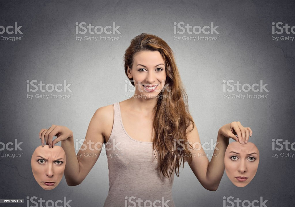 portrait beautiful happy girl holds two masks stock photo
