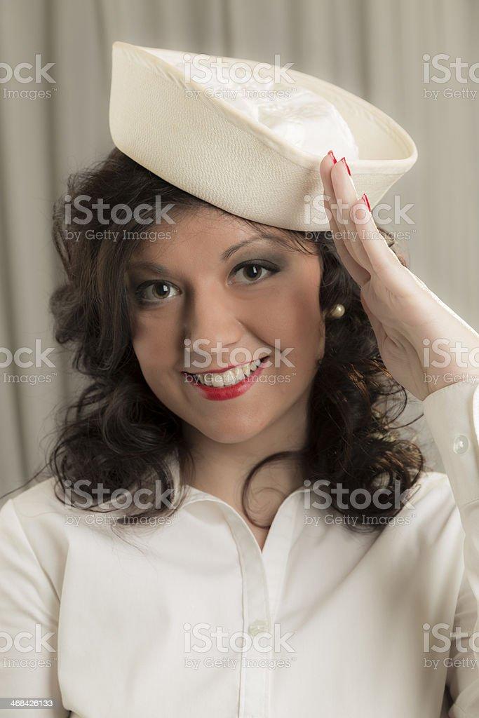 Portrait:  Beautiful woman wearing sailor hat. Saluting. Military. royalty-free stock photo