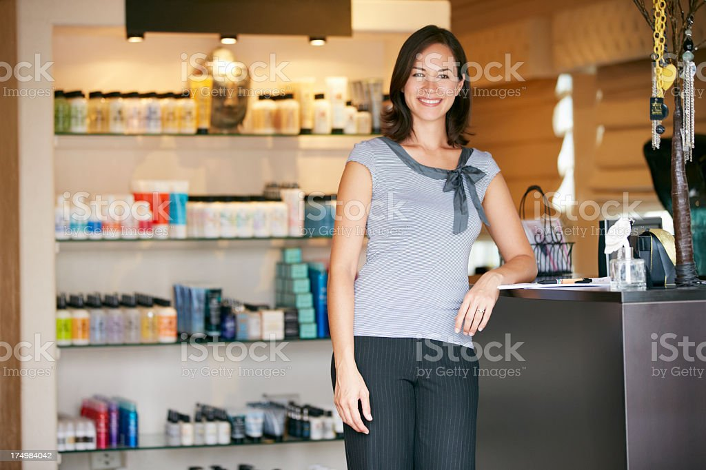 Portrait Beauty Product Shop Manager Leaning at the counter stock photo