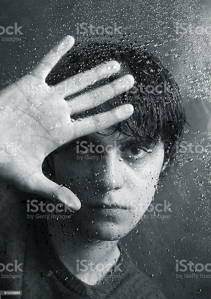 Portrait behind glass stock photo