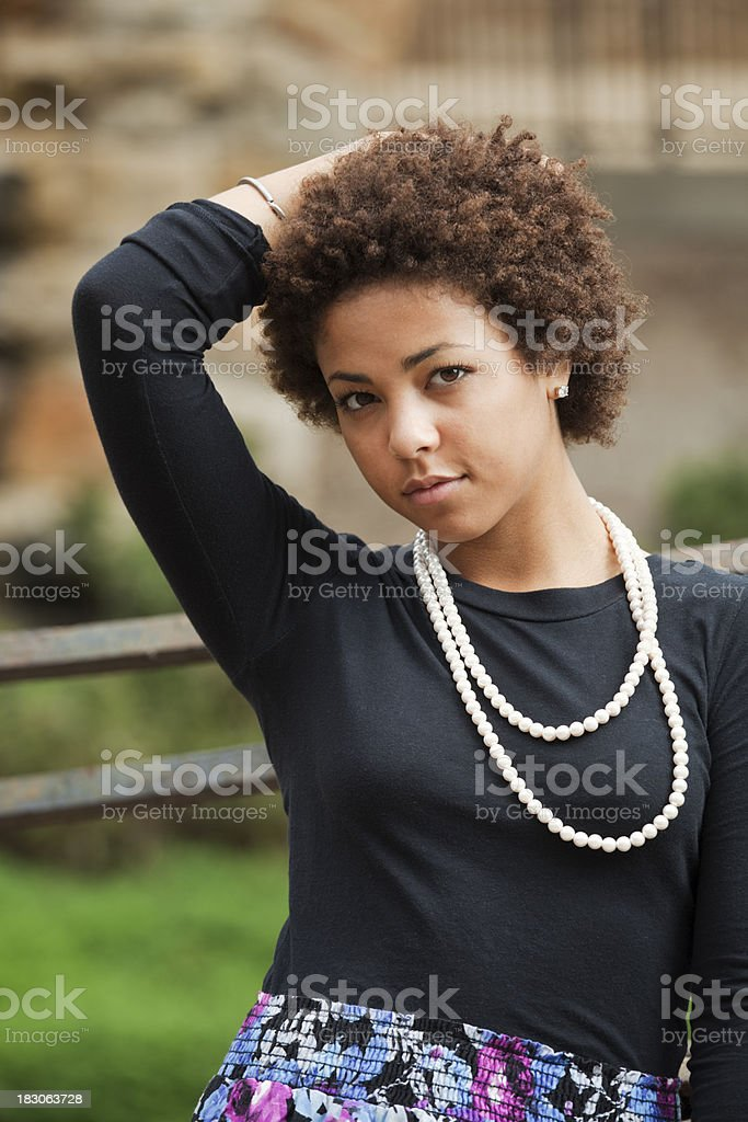 Portrait: Black Young Woman, Teenage Girl with Pearl Chain Necklace royalty-free stock photo